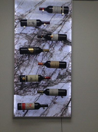 Wine rack. LED back lit Ziluo translucent Marble. Wine pegs.
